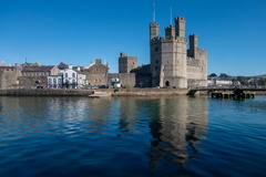 Caernarfon Water Front -- Caernarfon Castle and the waterfront is reflected in the Menai Strait