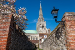 Chichester Twitten -- St Richard's Walk is a small twitten at the back of Chichester Cathedral which gives leads into the cloisters, the way the flint walls frame the walk to the cathedral is very pleasing in the spring sunshine with blossom on the trees.