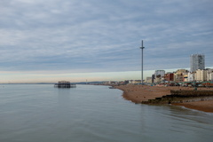 Empty Beach -- Brighton beach is quiet during the Winter season with no tourists in sight. The sea ripples underneath the derelict west pier and the i360 tourist attraction is moving up it's stick to give those inside a view.